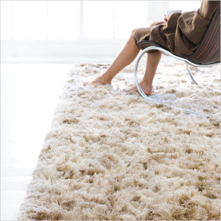 Area rug with long fluffy pile