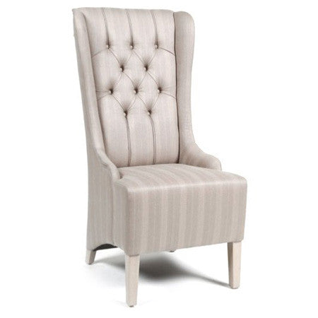 Wingback dining chair with tufting
