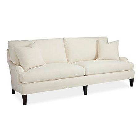 White slipcovered sofa with pillows