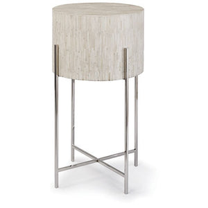 Round beige accent table with silver metal legs