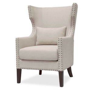 Wingback chair in fabric with nailhead trim