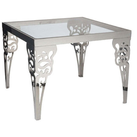 Silver metal end table with glass top and paisley design