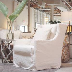 White chair in fabric slip cover