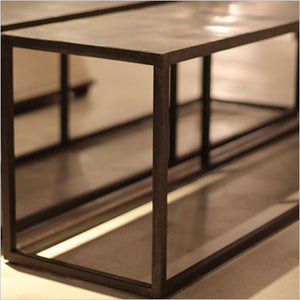 coffee table with iron frame and reclaimed rubber top
