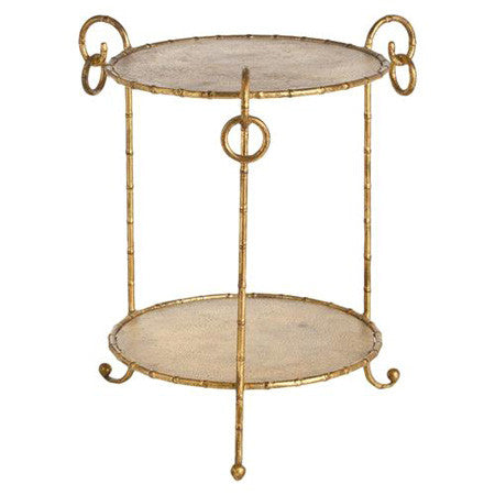 Round accent table in hammered iron with gold leaf finish