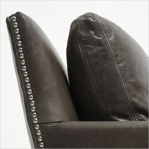 leather armchair with nail head trim