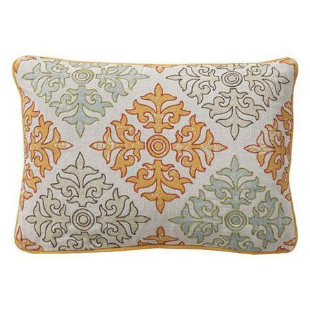 Pillow with graphic tiled print in orange, grey and turquoise