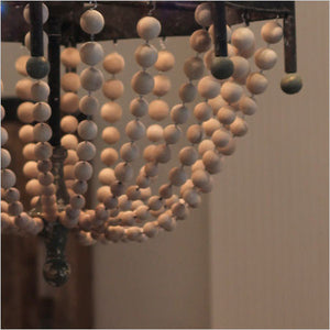 Cascading wood bead chandelier