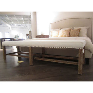Wood bench with upholstered seat and nailhead trim