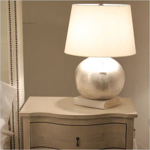 Round matte metallic silver table lamp with white shade