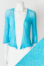Women's short lightweight 3/4 sleeve sheer shrug.