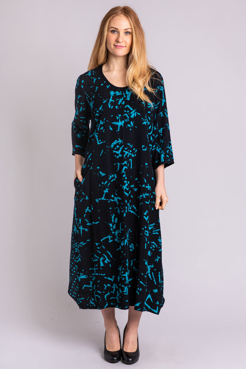 Women's long black and blue-green fabric print loose fitting dress with 3/4 sleeves.