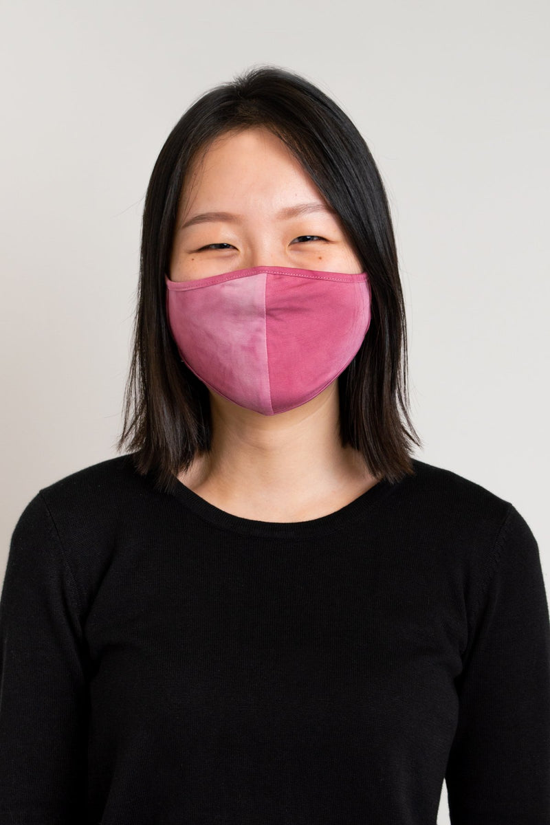 Unisex tie dye pink comfortable face mask made with natural bamboo fibers.