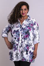 Women's white flower garden print long-sleeve tunic shirt with V-neck, collar, buttons, and roll-up sleeves.