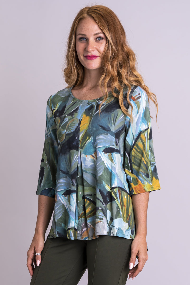 Women's khaki green print 3/4 sleeve front pleated shirt with round neckline.