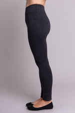 Grey, warm and comfy women's leggings with fleece interior. Made with sustainable and natural fibers, fair-trade, and available in plus-size. Left leg view.