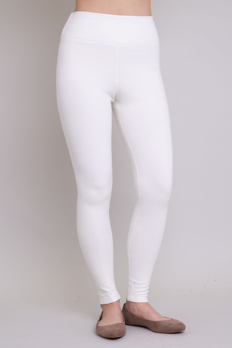 White, and comfy women's leggings with fleece interior. Made with sustainable and natural fibers, fair-trade, and available in plus-size.