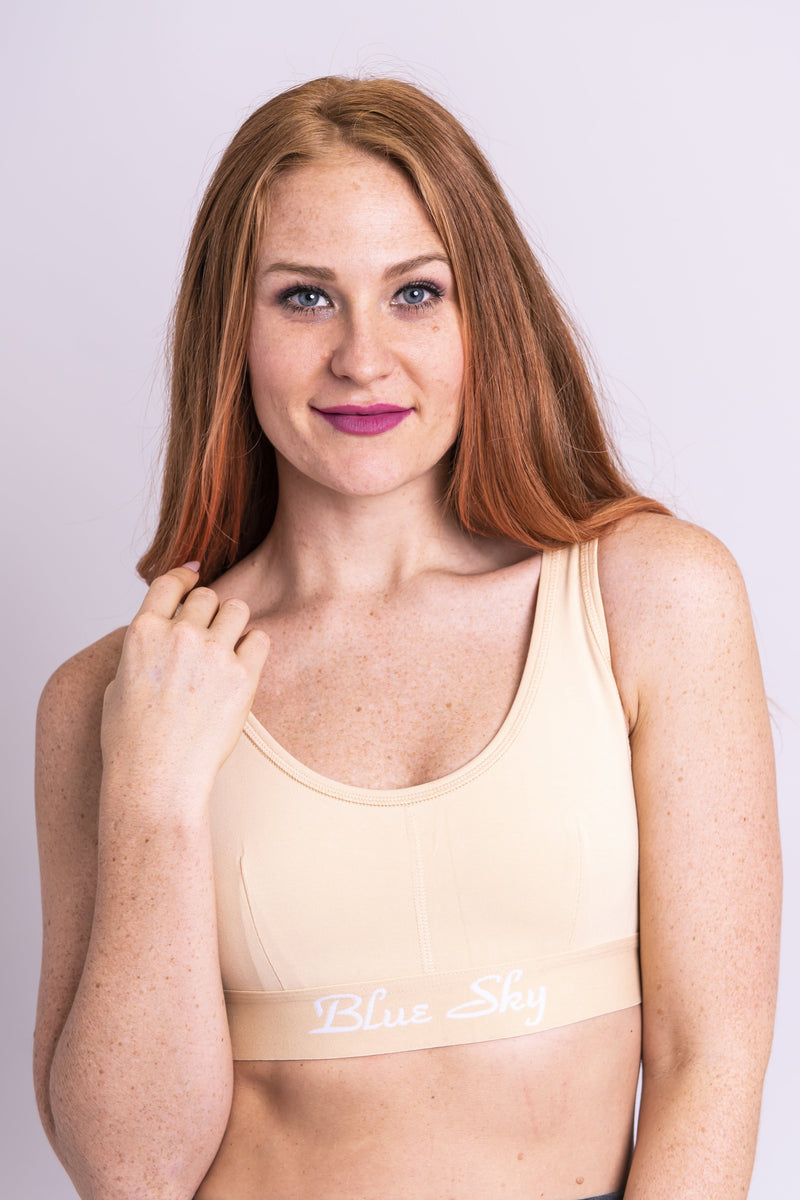 Women's beige workout bra made with all sustainable and natural fibers for ideal comfort and support.