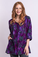 Women's plus-size purple batik art loose 3/4 sleeve shirt tunic with v-neck.