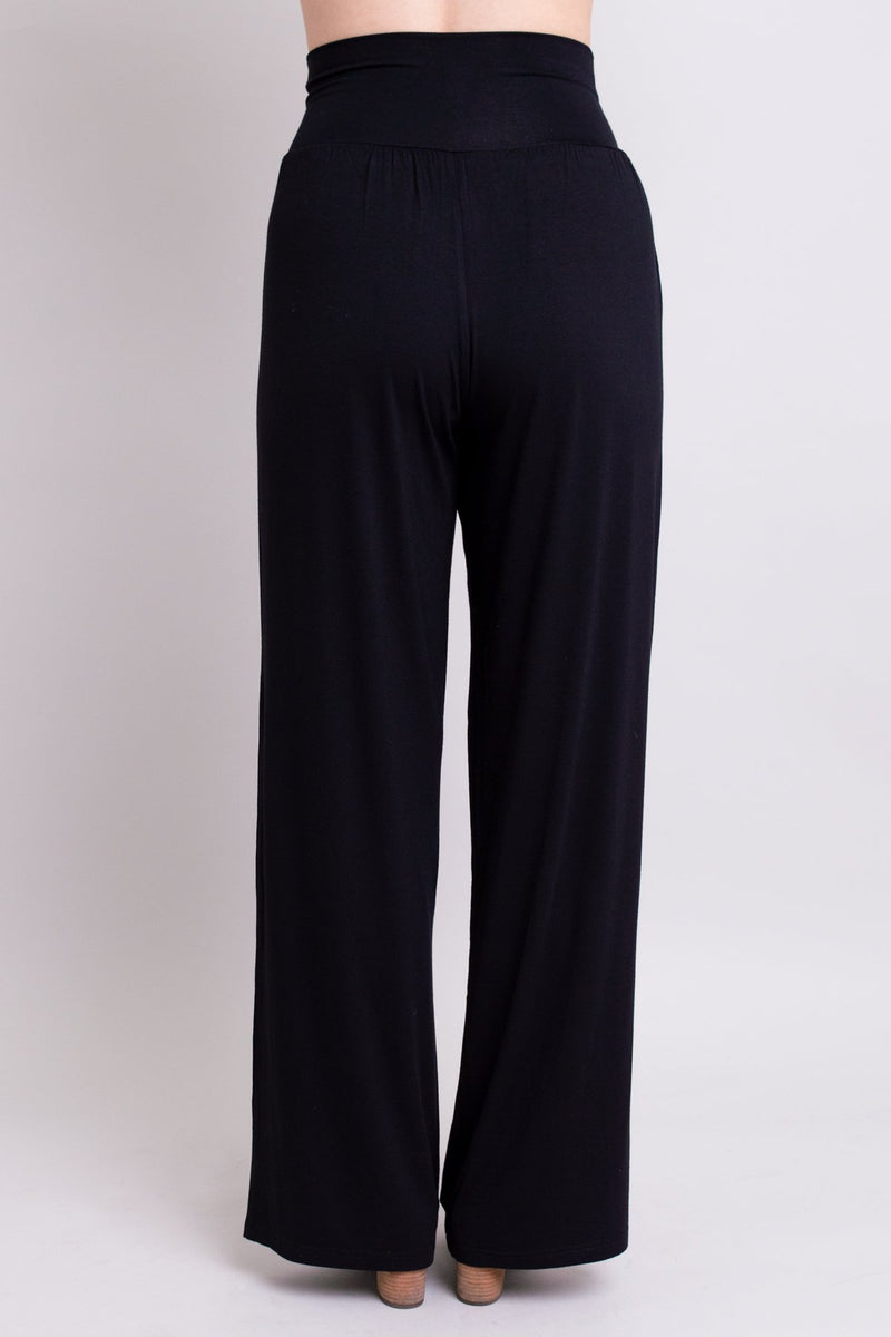 Women's high waisted comfortable tall black flowy pants with gathers at the waist. Made with all natural and sustainable fibers.