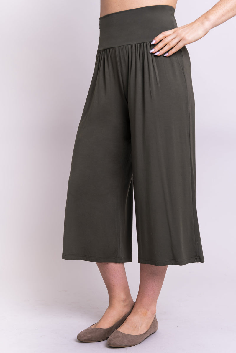 Women's high waisted comfortable cropped khaki green flowy pants with gathers at the waist. For yoga or casual wear.