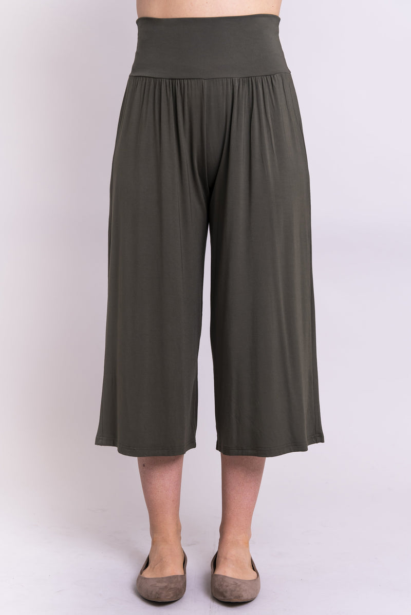 Women's high waisted comfortable cropped khaki green flowy pants with gathers at the waist.