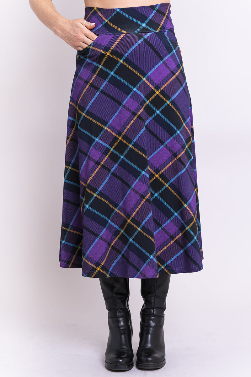Women's purple plaid long skirt with wide stretchy waistband and pockets, made with natural bamboo fibers.
