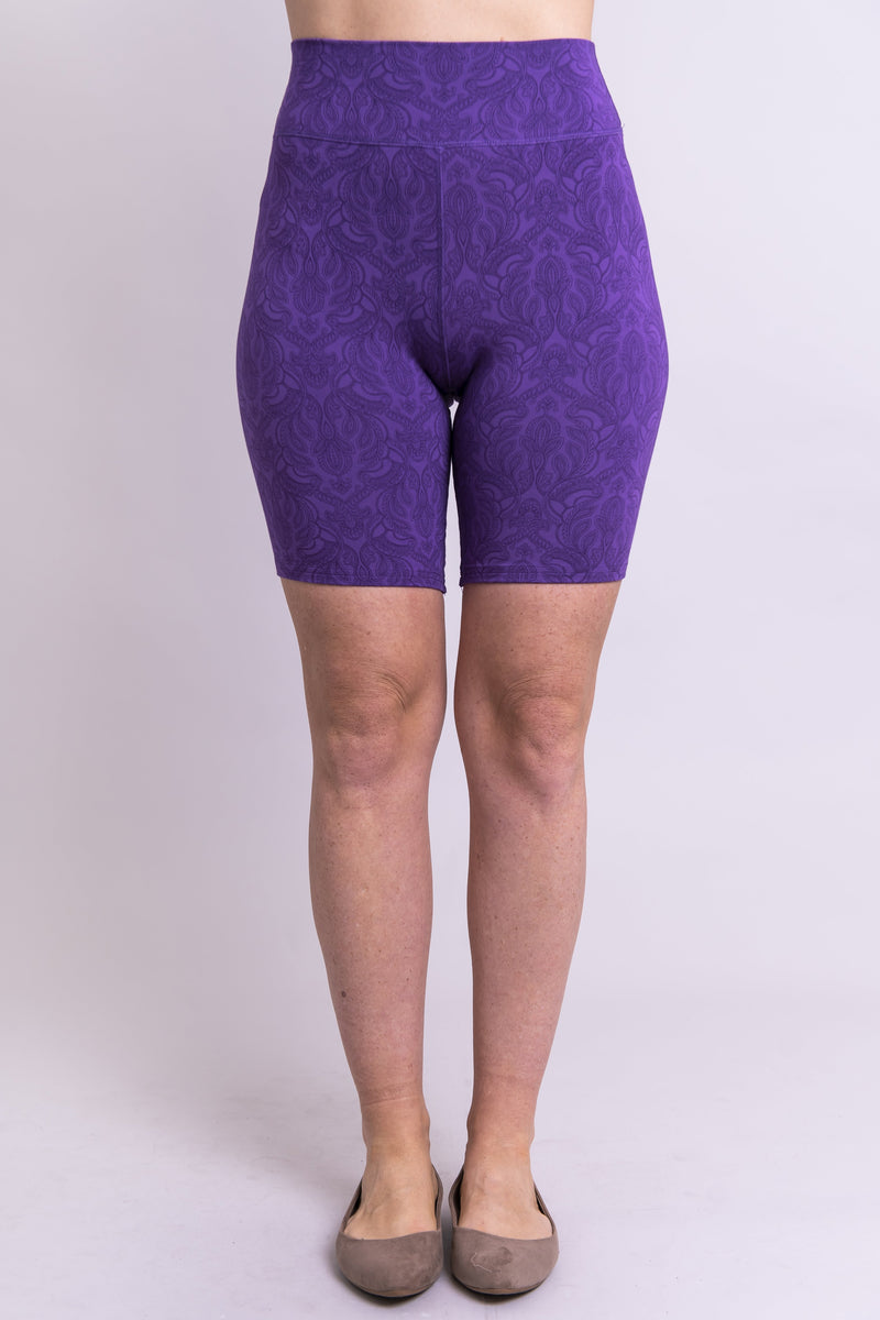 Women's purple print biker shorts for yoga, workout, or casual wear. Made with comfortable, stretchy, and sustainable natural fibers.