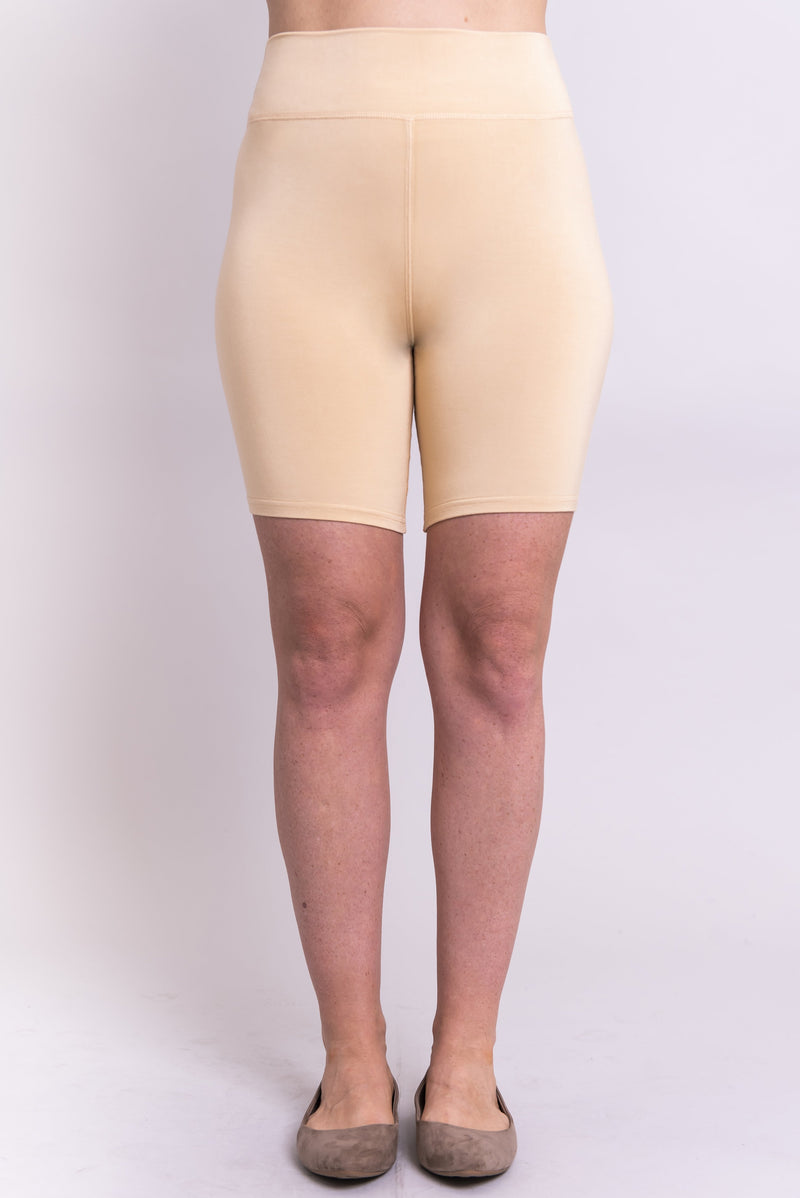Women's beige biker shorts for yoga, workout, or casual wear. Made with comfortable, stretchy, and sustainable natural fibers.