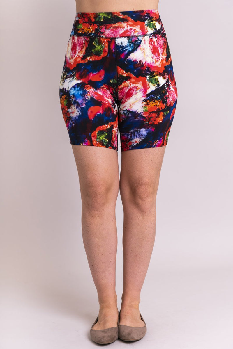 Women's coral abstract print biker shorts for yoga, workout, or casual wear. Made with comfortable, stretchy, and sustainable natural fibers.