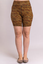 Women's gold cheetah print biker shorts for yoga, workout, or casual wear. Made with comfortable, stretchy, and sustainable natural fibers.