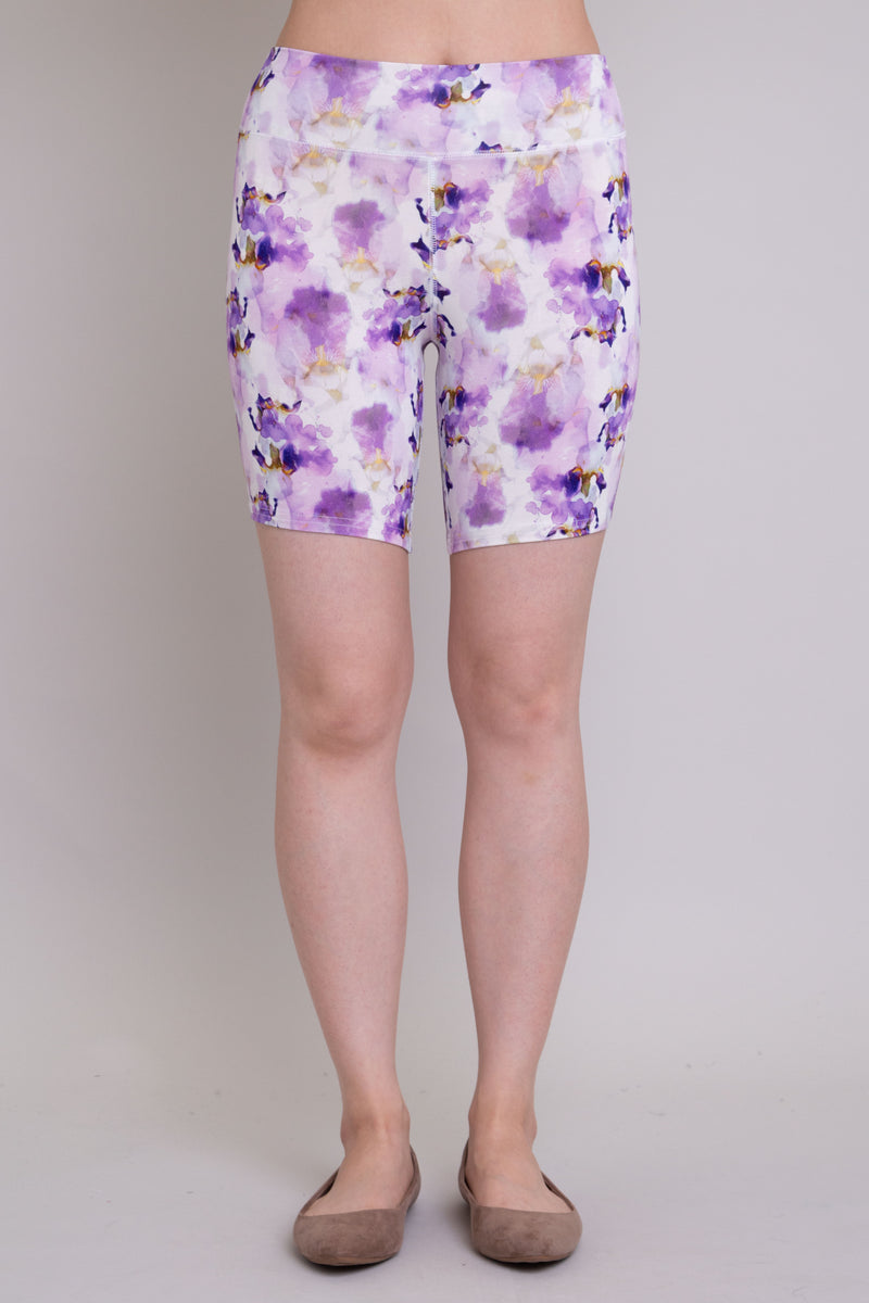 Women's purple orchid print biker shorts for yoga, workout, or casual wear. Made with comfortable, stretchy, and sustainable natural fibers.