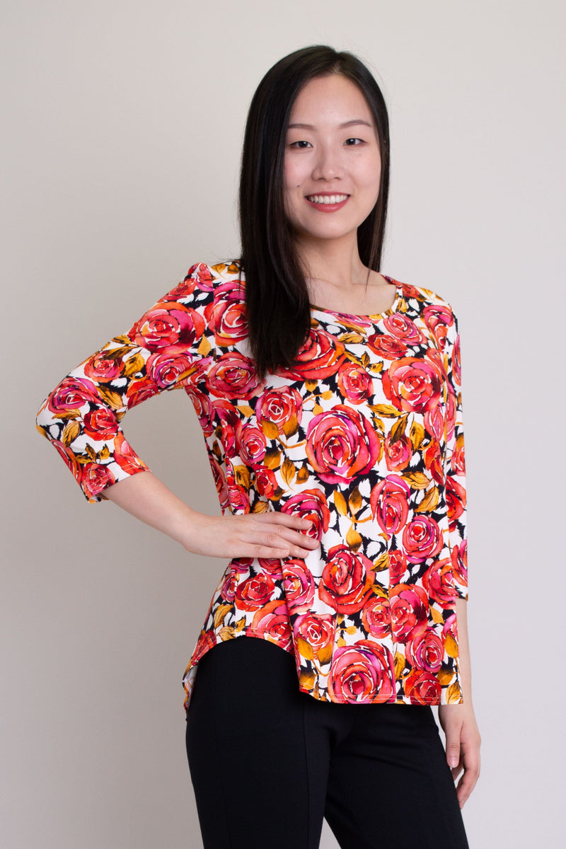 Women's pink rose print casual 3/4 sleeve, loose fitting shirt made of natural bamboo fibers.