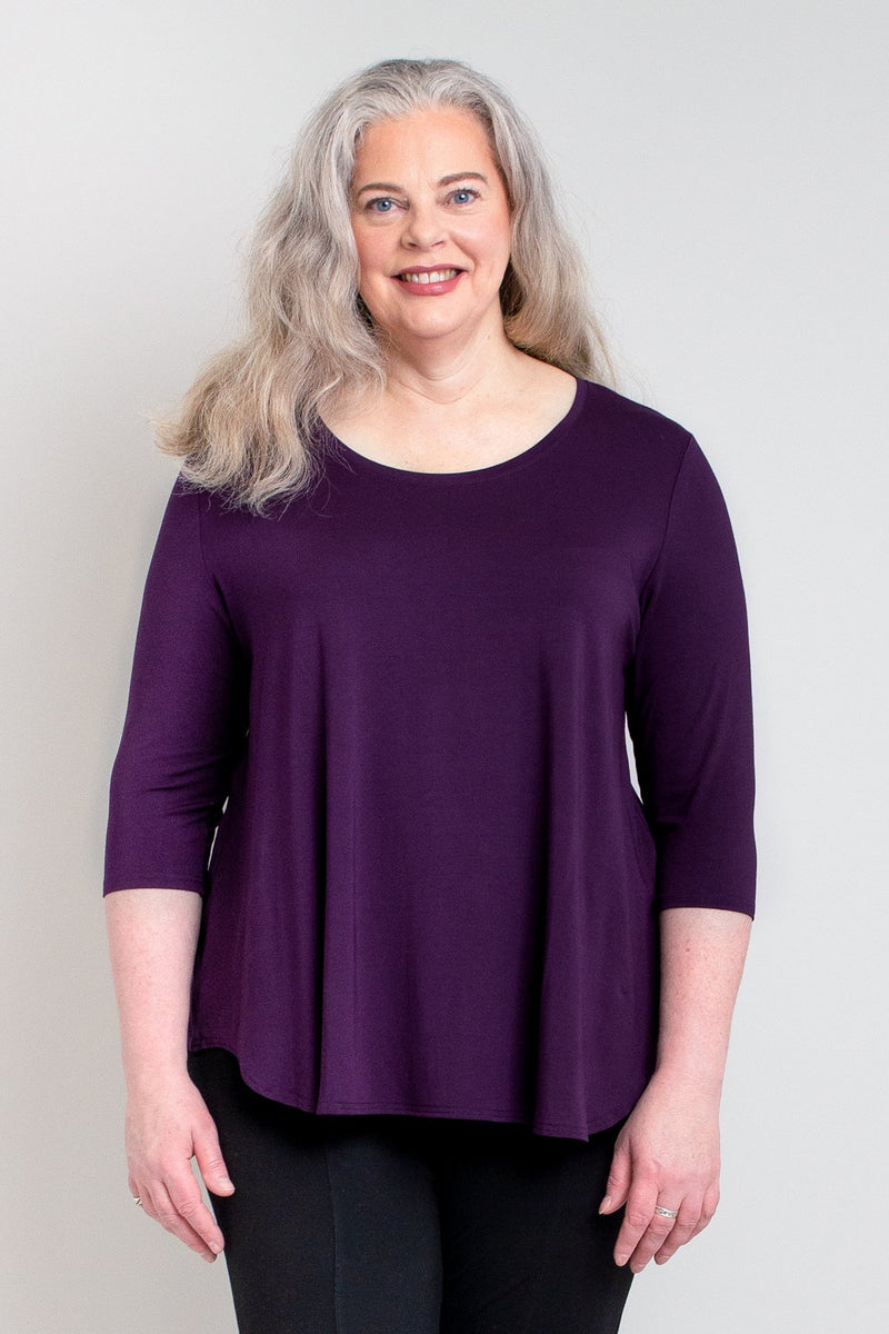 Women's purple crewneck 3/4 sleeve casual shirt with flowy cut. Made with sustainable and stretchy natural fibers.