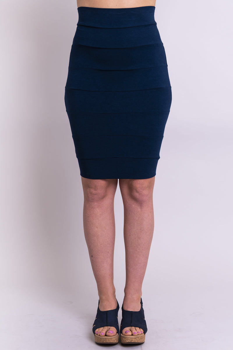Women's indigo blue high-waisted knee-length pencil skirt made with natural and sustainable stretchy fibers.