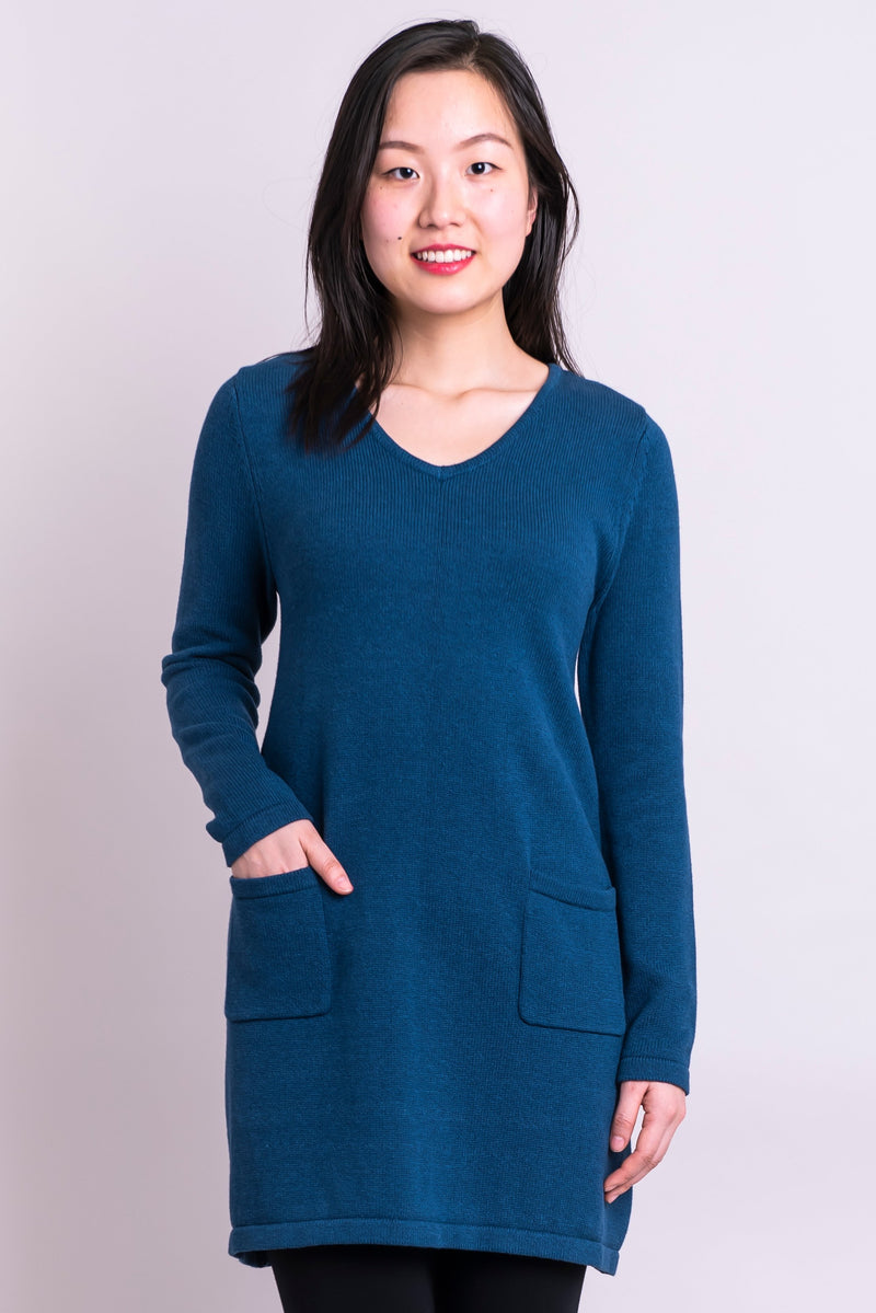 Women's blue tunic long-sleeve V-neck sweater dress with two front pockets.
