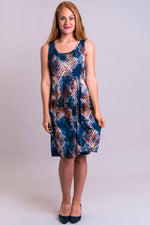 Women's blue snake print sleeveless short summer dress with round neckline, made with natural bamboo fibers.