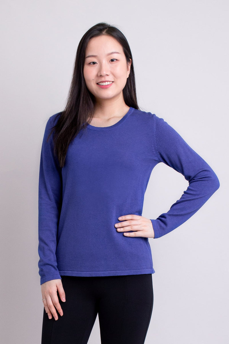 Women's petite violet blue long-sleeve sweatshirt with round neckline.