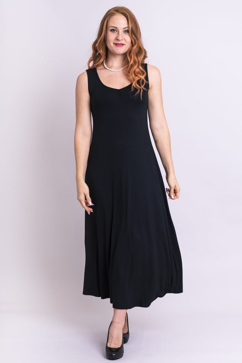 Women's black sleeveless evening gown with fitted bodice and sweetheart neckline.