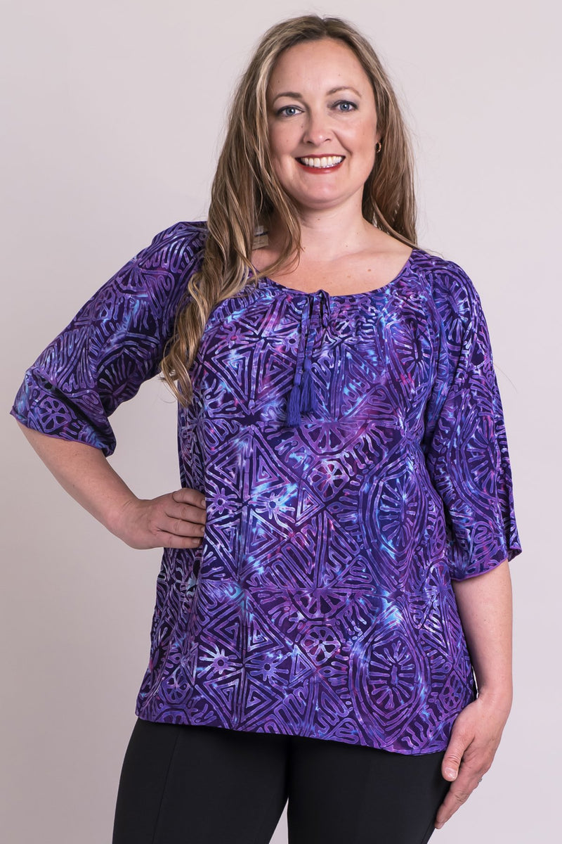 Women's purple aztec batik bohemian 3/4 sleeve draped shirt with wide neckline.