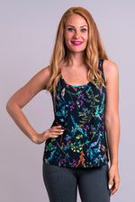 Women's colorful plant print sleeveless deep scoop neckline tank top with circular hemline, made of natural bamboo fibers.