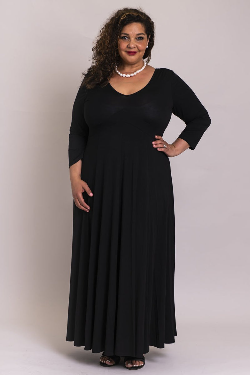 Women's black plus-size 3/4 sleeve long fitted-bodice dress with V-neck, made with natural bamboo fibers.