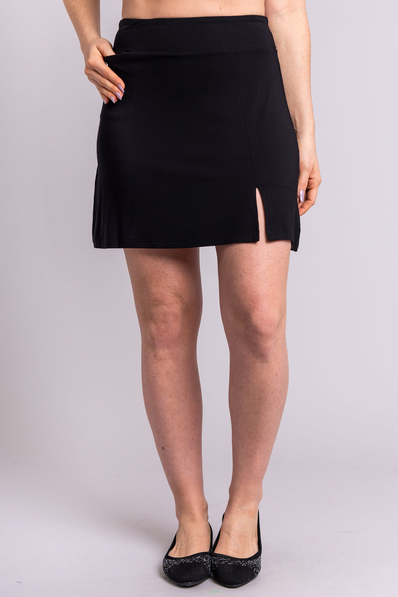 Women's black short skort skirt with slit, made with natural bamboo fibers.