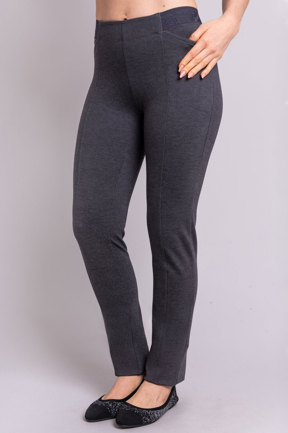 Women's petite grey tailored pant, with slim and narrow leg. Made of sustainable and natural bamboo fibers, fair-trade. Right side view with hand in pocket.