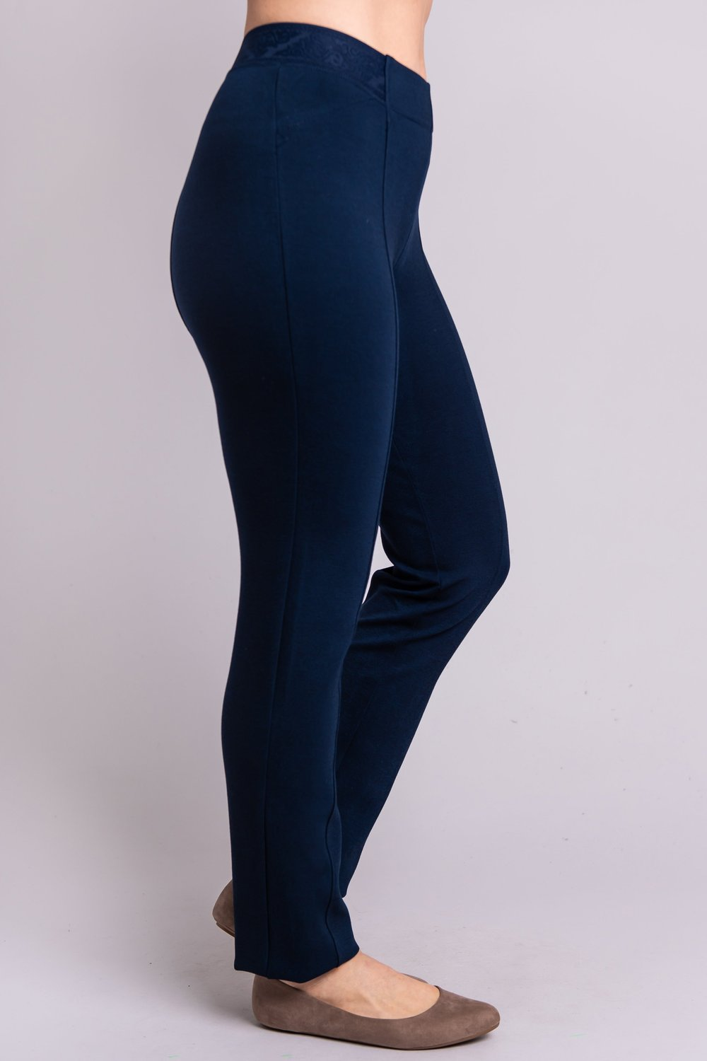 Right leg view of women's petite indigo tailored pant, with slim and narrow leg. Made of sustainable and natural bamboo fibers, fair-trade.