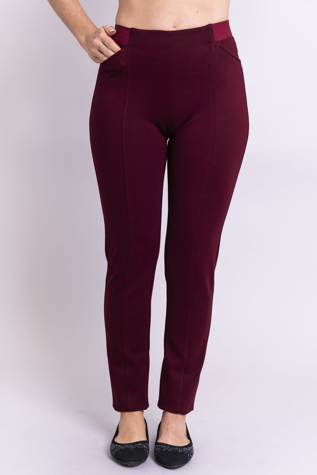 Front view of women's petite burgundy tailored pant, with slim and narrow leg. Made of sustainable and natural bamboo fibers, fair-trade.