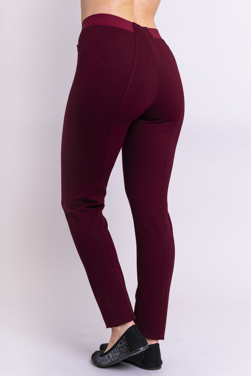 Back view of women's petite burgundy tailored pant, with slim and narrow leg. Made of sustainable and natural bamboo fibers, fair-trade.