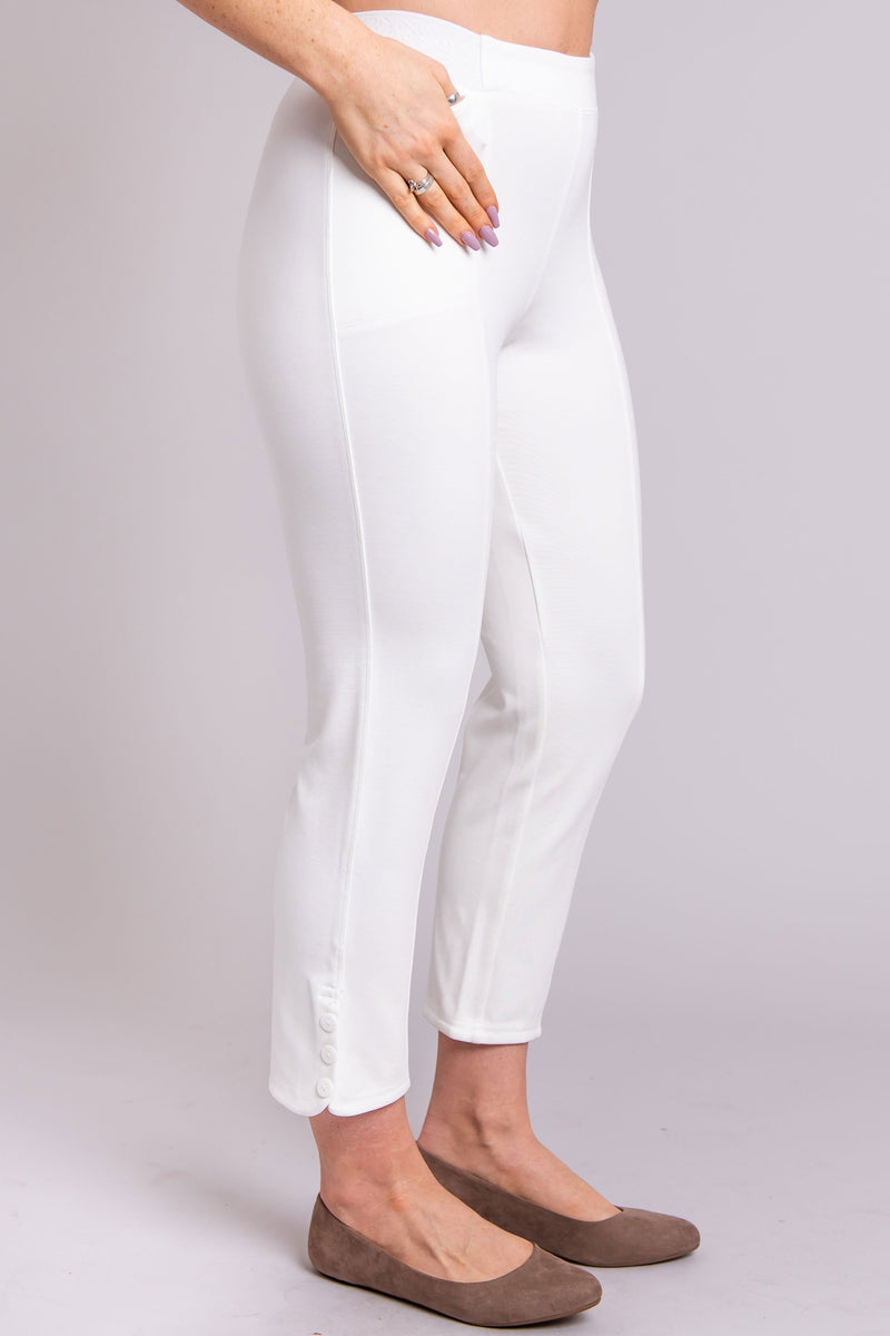 Women's white cropped slim tailored pant leggings with pockets and white buttons.