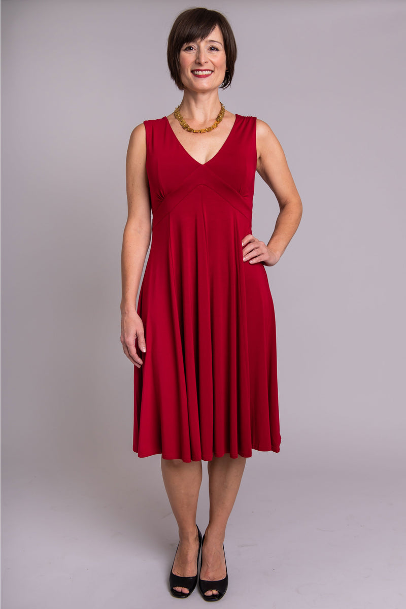 Women's burgundy red sleeveless fitted bodice short dress with V-neck, made with natural bamboo fibers.