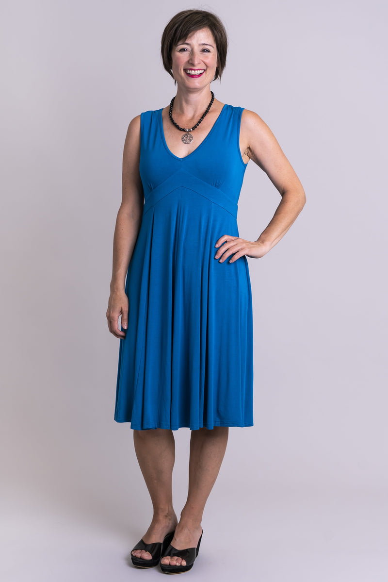 Women's blue sleeveless fitted bodice short dress with V-neck, made with natural bamboo fibers.